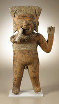Pre-Columbian:Ceramics, Standing Male Figure with his Right Hand to his Smiling Mouth.Veracruz. A.D. 300 - 700. Ceramic, traces of original paint...