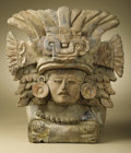 Pre-Columbian:Ceramics, Urn with Seated Deity. Zapotec. A.D. 550 - 850. Ceramic, traces oforiginal paint. Height 12 3/8 in. Width 11 in.. An ela...