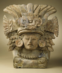 Urn with Seated Deity Zapotec A.D. 550 - 850 Ceramic, traces of original paint Height 12 3/8 in. Width 11 in.  An ela