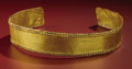 Pre-Columbian:Metal/Gold, Band-form Crown. Costa Rica or Panama. A.D. 700 - 1500. Gold,Weight 12.0 grams. Length 21 3/8 in. Width 1 ½ in.. This cr...