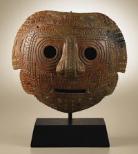 Convex Face Mask Calima 100 B.C. - A.D. 400 Burnished ceramic, traces of white paint Height 10 in. Width 11 3/8 in