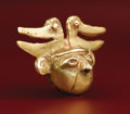 Pre-Columbian:Metal/Gold, Head-form Bell. Sinú. A.D. 400 - 1000. Gold, Weight 58 grams.Height 1 5/8 in. Width 2 13/16 in.. This striking bell in t...
