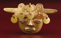 Pre-Columbian:Metal/Gold, Head-form Bell. Sinú. A.D. 400 - 1000. Gold, Weight 86 grams.Height 2 in. Width 3 5/8 in.. With its fuller, more modeled...
