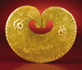 Pre-Columbian:Metal/Gold, Heart-Shaped Pectoral. Sinú. A.D. 400 - 1000. Gold, Weight 98grams. Height 5 ¼ in. Width 6 7/16 in.. This large, careful...