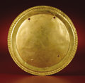 Pre-Columbian:Metal/Gold, Circular Pectoral. Calima. A.D. 400 - 1000. Gold, Weight 64 grams.Diameter 6 ¾ in.. The center portion of the pectoral is...