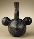 Pre-Columbian:Ceramics, Stirrup-spout Vessel. Chavín, Cupisnique. 1000 - 600 B.C..Burnished blackware. Height 9 1/2in. Width 8 11/16 in.. A comp...