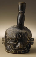 Pre-Columbian:Ceramics, Stirrup-spout Vessel: Fanged Deity. Chavín. 700 - 400 B.C..Burnished dark gray ceramic. Height 8 1/2 in. Width 5 1/2 in.. ...