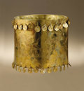 Pre-Columbian:Metal/Gold, Crown with Dangles. Moche (?). A.D. 100 - 500. Gold. Height 6 3/8in. Diameter 7 ½ in.. A crown of such unadorned design ...