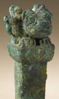 Pre-Columbian:Metal/Gold, Tumi Topped by an Animal Effigy. Moche. A.D. 100 - 600.Copper, turquoise or chrysacola. Height 5 7/8 in. Width 1 1/4 i...