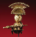 Pre-Columbian:Metal/Gold, Pendant, Seated Warrior. Moche. A.D. 100 - 500. Gold, Weight 6grams. Height 1 1/4 in. Width 2 1/8 in.. This miniature go...