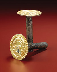 Pair of Gold and Silver Earspools Sicán A.D. 700 - 1100 Gold, silver-sheathed incised ear tubes (A) Diameter 2 1/...