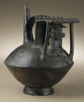 Pre-Columbian:Ceramics, Single-spout Strap-handle Vessel. Chimú. A.D. 1100 - 1400.Burnished blackware. Height 8 5/8 in. Depth 7 in.. The scene a...