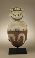 Pre-Columbian:Ceramics, Vessel with Figure Holding Cup. Chancay. A.D. 1000 - 1350. Ceramicwith white, rust, and dark brown slip. Height 16 3/4 in. ...