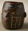 Pre-Columbian:Ceramics, Portrait Cup. Huari. A.D. 500 - 750. Polychrome ceramic. Height 5in. Width 5 1/2 in.. The head is formed by the entire c...