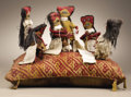 Pre-Columbian:Textiles, Group of Six Standing Figures on a Pillow. Chancay. A.D. 1000 -1350. Cotton and camelid fibers; Sticks. Height 15 in. Width...