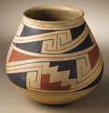 Native American:Pottery and Baskets, Casas Grandes Polychrome Pottery Jar. Circa 1200-1450 AD. Height 8in. Diameter 7 3/4 in.. This classic jar features a rou...