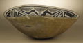 Native American:Pottery and Baskets, Mimbres Black on White Pottery Bowl. Circa 1000-1150 AD. Height 5in. Diameter 12 1/4 in.. This classic bowl is painted on...