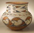 Native American:Pottery and Baskets, San Ildefonso Polychrome Pottery Jar by Ana Montoya. Circa 1910.Height 9 1/2 in. Width 11 in.. This classic three-color o...