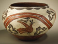 Native American:Pottery and Baskets, Zia Polychrome Pottery Jar. Circa 1930. Height 12 in. Width18 3/4 in.. This large three color storage jar is painted ...