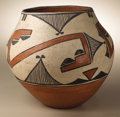 Native American:Pottery and Baskets, Zia Polychrome Pottery Jar. Circa 1920. Height 8 1/4 in.Diameter 8 3/4 in.. This olla is characterized by a concave b...