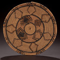 African, A SOUTH AFRICAN WOVEN FOOD TRAY . Zulu, early 20th century.10-1/4 inches diameter (26.0 cm). ...