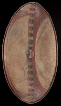 African, A KENYAN PAINTED LEATHER SHIELD . Massai, early 20thcentury. 42 inches high x 21-1/4 inches wide (106.7 x 54.0 cm). ...