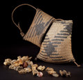 African, A CONGOLESE DIVINER'S ORACLE SET . Early 20th century. 8 incheslong (20.3 cm) (bag). ...