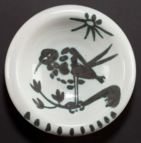 A MADOURA POTTERY EARTHENWARE BOWL AFTER PABLO PICASSO (Spanish, 1881-1973): BIRD ON BRANCH