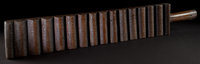 A NORTHERN AFRICAN WOOD WASHBOARD Senofu, 20th century 34-1/2 inches high x 5-1/2 inches wide (87