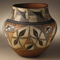 Native American:Pottery and Baskets, Acoma Polychrome Pottery Jar. Circa 1910. Height 11 in. Diameter 12in.. This four color olla has a high neck and slight s...