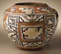 Native American:Pottery and Baskets, Acoma Polychrome Pottery Jar. Circa 1930. Height 9 1/2 in. Diameter11 3/4 in.. This jar is characterized by its concave b...