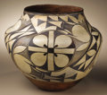 Native American:Pottery and Baskets, Acoma Polychrome Pottery Jar. Circa 1920. Height 9 3/4 in. Diameter12 in.. This classic olla has a concave base, flaring ...