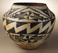 Acoma Polychrome Pottery Jar Circa 1940 Height 8 3/4 in. Diameter 9 1/2 in.  This olla features a small concave base, fl...