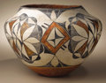 Native American:Pottery and Baskets, Acoma Polychrome Pottery Jar. Circa 1920. Height 9 1/4 in. Diameter13 in.. This classic olla has a concave base, flaring ...