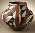 Native American:Pottery and Baskets, Acoma Polychrome Pottery Jar. Circa 1920. Height 10 1/4 in.Diameter 11 in.. This classic three-color olla has a concave b...