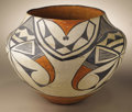Native American:Pottery and Baskets, Acoma Polychrome Pottery Jar. Circa 1930. Height 9 1/4 in. Diameter12 in.. The three-color olla is characterized by a con...