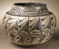 Native American:Pottery and Baskets, Zuni Polychrome Pottery Jar. Circa 1885. Height 9 1/4 in. Width 121/4 in.. This three-color jar of classic olla form has ...