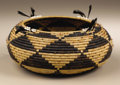 Native American:Pottery and Baskets, Pomo Coiled Gift Basket. Circa 1900. Height 3 in. Diameter 7 in..This tightly coiled round basket is decorated with stepp...