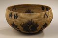 Native American:Pottery and Baskets, Miwok-Paiute Coiled Basket. Circa 1910. Height 5 1/8 in. Diameter10 in.. This well made bowl is decorated with a variety ...