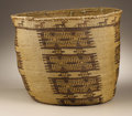 Native American:Pottery and Baskets, Skokomish Twined Storage Basket. Circa 1910. Height 13 3/4 in.Diameter 17 in.. This large storage basket is a classic exa...