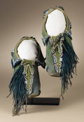 Native American:War Shirts/Garments, Kiowa Painted and Fringed Moccasins. Circa 1885. Length 10 1/4 in..This pair features native tanned and painted deerskin ...