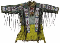 Sioux Warrior's Shirt depicting American flags Circa 1890 Length 38 1/2 in.  This shirt is tailored in typical Plains fa...