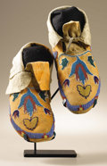 Native American:War Shirts/Garments, Northern Plains Moccasins / Possibly Fort Peck Assiniboin. Circa1890. Length 10 3/4 in.. This pair features native tanned...(Total: 2 Items)