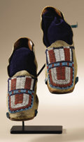 "Native American:War Shirts/Garments, Cheyenne Moccasins. Circa 1890. Length 9 1/2 in.. This pairfeatures native tanned hide uppers with a ""U"" shaped panel in ...(Total: 2 Items)"