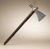 Pipe Tomahawk by J. Wilson Circa 1850 Length 23 in. overall; Length 8 1/2 in. the blade  The hand forged iron blade is d...