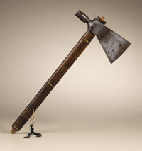 Pipe Tomahawk by J. Wilson with Bead and Coin Pendant Circa 1850 Length 19 1/2 in. overall; Length 8 in. the blade  This...