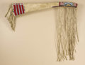 Native American:Beadwork, Crow Gun Case. Circa 1875. Length 51 in.. This native tannedbuffalo hide gun case is decorated at the muzzle end and butt...