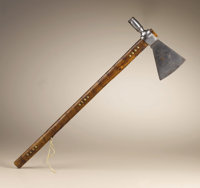 Pipe Tomahawk by J. Wilson Circa 1850 Length 23 3/4 in. overall; Length 8 1/4 in. the blade  This hand forged iron pipe...