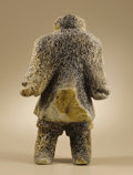 Native American:Textiles, Whalebone Carving of an Inuit Hunter. Circa 1973. Length 15 in..The flat triangular area on the stomach suggests the arti...