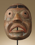 Native American:War Shirts/Garments, Kwakiutl Shamans Mask. Circa 1970. Height 10 3/4 in. Width 6 3/4in.. This carved and painted cedar wood mask has human fe...